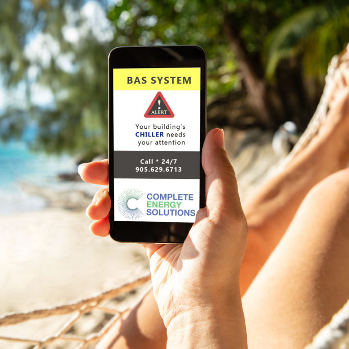 Woman Using Mobile Phone With White Screen Display Lying On Hammock At Beach